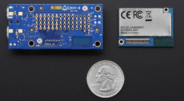The Intel Edison (right) and breakout board (left) compared to a quarter.